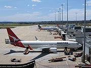 Overview of Melbourne's Tullamarine Airport Terminal 1 with a Qantas Boeing 737 and Jetstar aircraft